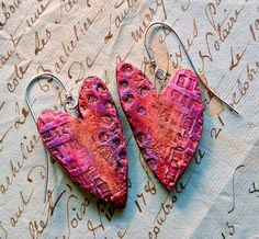 Stories They Tell (blog). Textured heart earrings, 2015 -- polymer clay, Acrylic paint, crayons, handmade texture plate and earwires