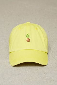 A cotton baseball cap featuring a front pineapple embroidery, a curved brim, and an adjustable back. Pineapple Hat, Pineapple Clothes, Bones Tumblr, Bandanas, Pineapple Embroidery, Embroidered Hats, Dad Caps, Yellow Fashion, Cute Hats