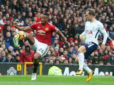 Antonio Valencia of Manchester United in action with Christian Eriksen of Tottenham Hotspur during the Premier League match between Manchester United...