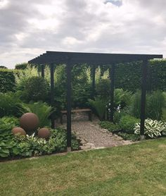 The pergola kits are the easiest and quickest way to build a garden pergola. There are lots of do it yourself pergola kits available to you so that anyone could easily put them together to construct a new structure at their backyard. Pergola With Roof, Pergola Patio, Pergola Plans, Pergola Kits, Backyard Landscaping, Pergola Ideas, Roof Ideas, Modern Pergola, Covered Pergola