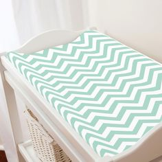 Mint Chevron Changing Pad Cover by Carousel Designs. Keep your baby comfortable and dry with this changing pad cover, designed to fit most contoured changing pads. Machine washable for easy clean-up. Fits standard contoured changing pads approximately x Mint Chevron, Mint Nursery, Carousel Designs, Changing Pad, Clean Up, Mattress, Zig Zag, Cover, Baby