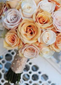 This lovely, soft orange bouquet is perfect for any wedding! Photo by Andrea Polito Photography