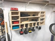 Drill Storage Charging Station is part of Diy garage storage - 4 tall x 10 deepUnit does not include drills, bits, drivers, or other accessories shown in the pictures They are for demonstration purposes only Workshop Storage, Workshop Organization, Garage Workshop, Garage Organization, Organization Ideas, Woodworking Organization, Workshop Bench, Workshop Plans, Diy Workshop