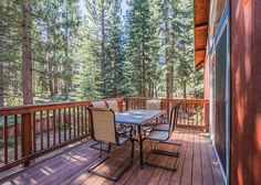 Enjoy the forest view from the large balcony, table seating, just outside main living area