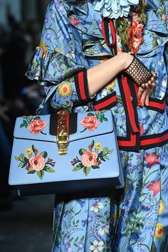 A moldel walk the runway during the Gucci Cruise 2017 fashion show at the…