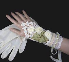 Vintage Upcycled Crochet Wrist Cuff, Bridal Bracelet - Lace, Beads, Roses - Corset Lacing - OOAK by WaywardWomen on Etsy https://www.etsy.com/listing/98221354/vintage-upcycled-crochet-wrist-cuff