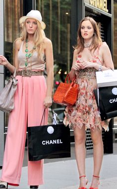 """Our favorite frenemies shopping Chanel in Paris! They were actually more like besties in this scene, so I wanted their color palettes to play into that: Matching soft cosmetic neutral tones with saturated personal hints, like Serena's turquoise Suzan Galani necklace and Blair's Orange Nancy Gonzalez croc bag.  Loving the masculine inspired Suno pink pants on S, a total nod to Mlle Chanel!"""