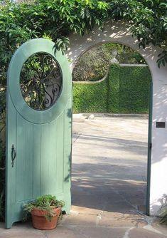 Gate with round window, stucco wall