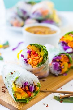 These Fresh Spring Rolls are a colorful, crunchy vegan meal that are perfect for a light lunch, dinner or appetizer! They are served with an amazing Peanut Ginger Dip and are gluten free!