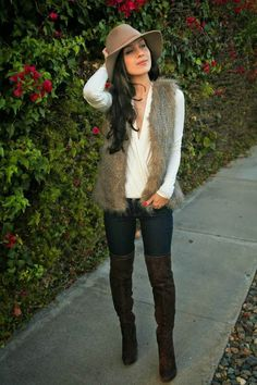 The HONEYBEE boho winter. Fedora hat, OTK boots, white top, skinnie jeans & faux fur vest