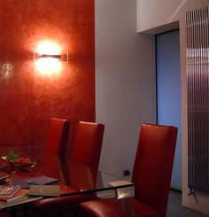 Architecture. Casa TC. duplex renovation. A project by OfficineMultipo. red chair sedie rosse, red wall