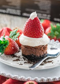 Let these Chocolate Cheesecake Santa Hats take you on a taste bud adventure of decadent cheesecake bites topped with whipped cream and strawberries.
