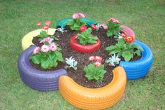 Flower bed made from old tires and small tire in the center.