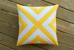 Pillow Tutorial: one yard of striped fabric, sewn together on the bias.