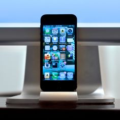 """Short for """"Obsessively Clean,"""" OCDesk raises the bar for workspace cleanliness with elegant docking stations for your iPhone 5. OCDock is the only iPhone dock dedicated to work in symbiosis with the Apple iMac and Thunderbolt Displays. It is also the first dock to actually remove items from your desk, freeing up valuable workspace and boosting productivity."""
