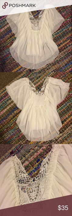 Free people white blouse small Size small white free people blouse. Mint condition. The inside of the top is a sweater like material with a built in tank. Free People Tops