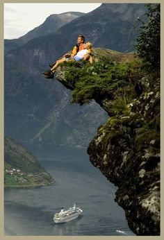 Norway  Definitely not me on that rock...not with my fear of heights!  I'd be comfortable on the boat far below!
