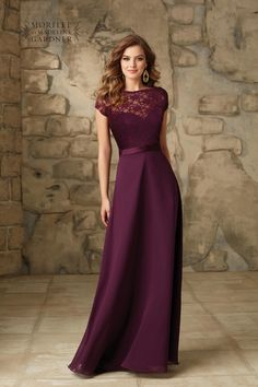 A Removable Lace Bateau Jacket on a long strapless chiffon dress with Low V-Back and Satin Trim. Zipper Back. Shown in Eggplant. Available in all Solid Lac