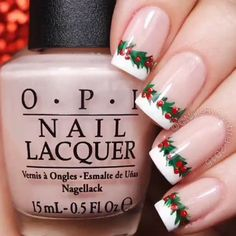 Give the classic French manicure a holiday twist with this holly outline. Nails by Cambria.