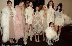 One for the photo album: The whole Klan decided to pose backstage sans Kanye...