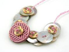 Pink Flower Button Necklace by TrinketsNWhatnots on Etsy  Lovely handpainted wood buttons layered on top of mother of pearl buttons.  Amazing texture.   www.trinketsnwhatnots.etsy.com