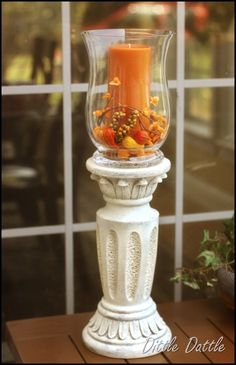 She glued a cheap glass vase to the base of an old pedestal and amek a trash to treasure candlestick