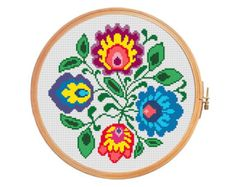 Polish wycinanki flowers - cross stitch pattern.  Floss: DMC Canvas: Aida 14 Grid Size: 93W x 93H Design Area: 6,50 x 6,50 (91 x 91 stitches)  Number of colors: 16  Use 2 strands of thread for cross stitch.  ONLY PATTERN! This PDF file counted cross stitch pattern is available for instant download.  This PDF pattern Included: - Color image of the finished design - Color Block Chart - Color Floss Legend with DMC stranded cotton.  In order to open these files you will need Adobe Reader, which…