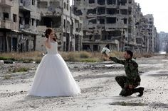 A newly married couple took their wedding photos in Homs, Syria's most devastated city
