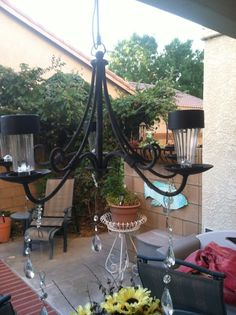 Solar lights from the 99cent store glued onto outside iron chandelier. .