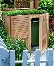 Grassy and green bin storage. great for hiding garbage can/compost/or garden tools.