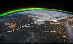 """""""A recent viral video stitching together time-lapse footage from the International Space Station wowed viewers with a view of earth never seen before. But what everyone missed except one eagle-eyed writer at Midwest Energy News was that the video featured the glowing lights of one """"enormous 'city' in the middle of nowhere."""" That """"city,"""" Ken Paulman discovered, was in fact the fires of natural gas being flared off from thousands of wells in the Bakken oil shale formation. Without a pipeline…"""