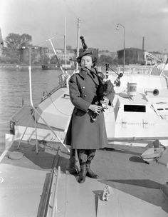 "Piper Flossie Ross of he Canadian Women's Army Corps (C.) Pipe Band on the deck of a surrendered German ""E""-boat, Wilhelmshaven, Germany, 4 October 1945 ~ Canadian Soldiers, Canadian Army, Canadian History, Military Women, Military Army, Military History, Women's Army Corps, E Boat, Brave Women"