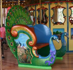 """Gorgeous peacock carousel chariot from """"The Carousel Works"""" -- what fun it would be to ride in this one!  Click through to see many more creative designs."""