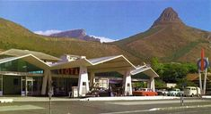 Cape Town features the world famous Table Mountain, beaches close to the city, shop at V&A Waterfront, ferry trips across the bay to Robben Island. Cities In Africa, V&a Waterfront, Cape Town South Africa, Table Mountain, Most Beautiful Cities, Vintage Photographs, Mansions, City, Places