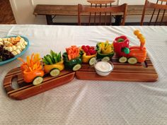 Veggie train - made from peppers, carrots, cucumbers, and cherry tomatoes. Held together with toothpicks.