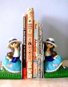 "Vintage Bookends | What dolls! This pair would brighten up any shelf. The bottom is covered in blue felt & has a sticker that says ""Created by Earl Bernard Made in Japan."" Bernard made a variety of awesome bookends in the 1950s & 60s."