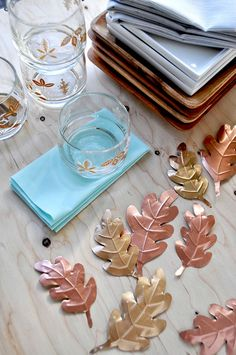 Anthro Hack: Metal leaves If you see the Anthropologie 2104 store display with metal flashing, copper and birch see this from Oh Happy Day!