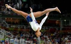 Great Britain's Claudia Fragapane competes on the beam.