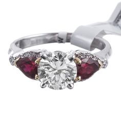 Round Diamond 1.38ct Three Stone Ring with Intense Red Ruby Accents