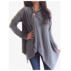 "Chic Grey Cape Cardigan This cardigan has a very chic feel & the style looks similar to a cape. It's a great substitute for wearing a jacket{actual color of item may vary slightly from photos}  •shoulders:18"" •chest:22"" •waist:26""w •length:35""/27"" •sleeve:21.5""  Material:68%polyester27%rayon5%spandex ️Dry Clean  Fit:true/style could probably work for med too Condition:no rips no stains light balling  ❌no holds ❌no trades ♥️️bundles of 3/more items get 20% off bobeau Sweaters Cardigans"