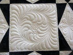 Feathered circle with pebbles ring surround and a feather border within the block by Green Fairy Quilts