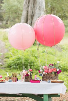 Love this idea of DIY hot air balloon flower centerpieces. See the full party at www.prettymyparty.com.