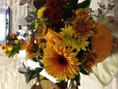 Carved out pumpkins as vases, filled with fall colored flowers for an October #wedding #reception. So much fun, especially if someone else does the carving!!! www.teatimeinc.com