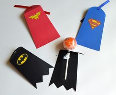 | LOLLIPOP/CAKE POP CAPES | Superhero lollipop or cake pop capes will be the perfect finish to your superhero party, halloween or valentines day treat. This set includes Superman, Batman and Wonder Woman, Batgirl (pink) which can be assorted to your preference. Each lollipop cape includes the superhero symbol on cape and a ribbon piece to keep the cape attached to the stick. LOLLIPOPS NOT INCLUDED. | CUSTOMIZING CAPES | We currently have the following superhero capes available: -Batman -Super...