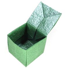 page Instructions to learn how to make an origami cube with a hinged top. Origami Car, Origami Bowl, Origami Mouse, Origami Star Box, Origami Models, Origami Fish, Origami Folding, Origami Design, Origami Instructions