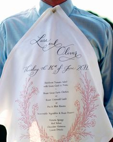 Screen-printed menu napkins (which double as keepsakes) featured buttonholes so male guests could attach them to their shirts.
