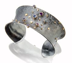 Sydney Lynch | Pleiades cuff: sapphires and amethysts, 18k gold and oxidized…