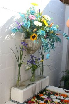 Loved doing this. Crunch time..had to leave the venue in 20 minutes and we had this last focal point arrangement to do. It was a WOW done under pressure..so please. it pops sunflower yellow and turquoise with the soft pink and huge white chrysanths, orchids and irises