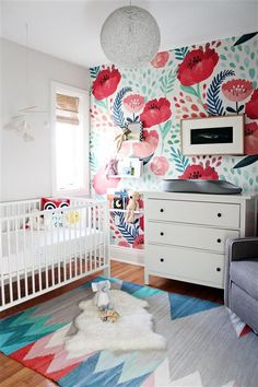 Baby girl's nursery with accents in floral and geometrics. #NurseryStickers