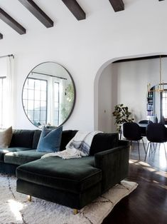 Round mirrors have rolled in, and they're here to stay. Why are they so popular, and how can you use them in your home? We've got answers.